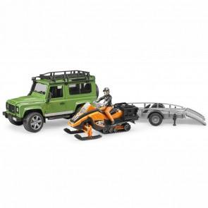 BRUDER 02594 Land Rover Defender Station Wagon mit Anhänger,  Snowmobil mit Fahrer und Zubehör